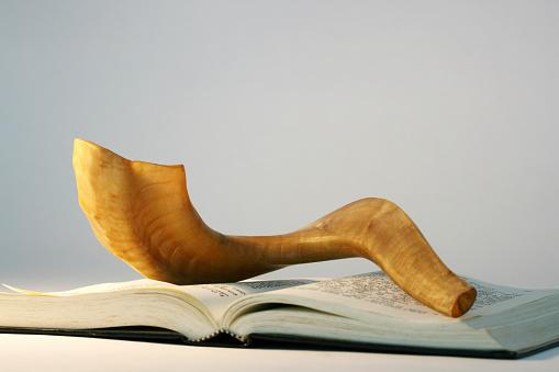 Shofar on a bible book at Rosh Hashanah 173929544