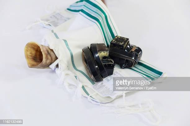 shofar with prayer shawl over white background - jewish prayer shawl stock pictures, royalty-free photos & images