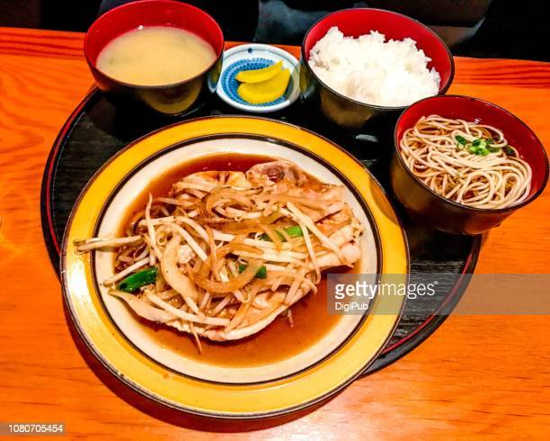 Shogayaki (stir-fried pork with ginger) and buckwheat soba lunch meal served in tray on table