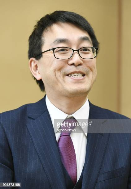 Shogi champion Yoshiharu Habu smiles during a press conference in Tokyo on Jan 5 following the Japanese government's decision to confer the People's...