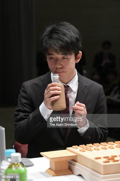 Shogi player Sota Fujii drinks a sip of latte before the match against Yoshiharu Habu on February 17 2018 in Tokyo Japan