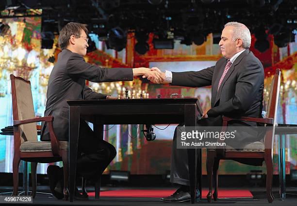 Shogi player Yoshiharu Habu and former chess world champion Garry Kasparov shake hands after an exhibition match at nicofarre on November 28 2014 in...
