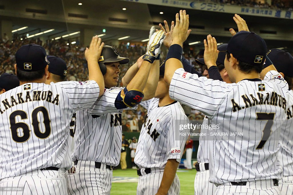 Shogo Akiyama #55 (2nd from left) of Japan celebrates with the team after hitting a game-ending home run in the bottom half of the seventh inning during the WBSC Premier 12 third place play off match between Japan and Mexico at the Tokyo Dome on November 21, 2015 in Tokyo, Japan.