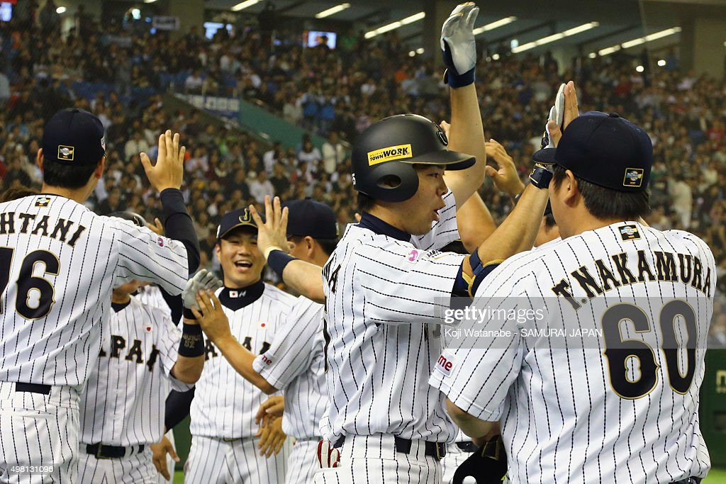 Shogo Akiyama #55 (2nd from right) of Japan celebrates with the team after hitting a game-ending home run in the bottom half of the seventh inning during the WBSC Premier 12 third place play off match between Japan and Mexico at the Tokyo Dome on November 21, 2015 in Tokyo, Japan.