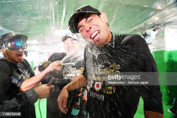 Shogo Akiyama of Japan is doused with champagne after the WBSC Premier 12 final game between Japan and South Korea at the Tokyo Dome on November 17,...