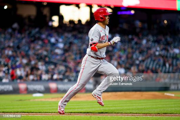 Shogo Akiyama of the Cincinnati Reds runs to first on a ground out in the fourth inning against the Colorado Rockies at Coors Field on May 14, 2021...