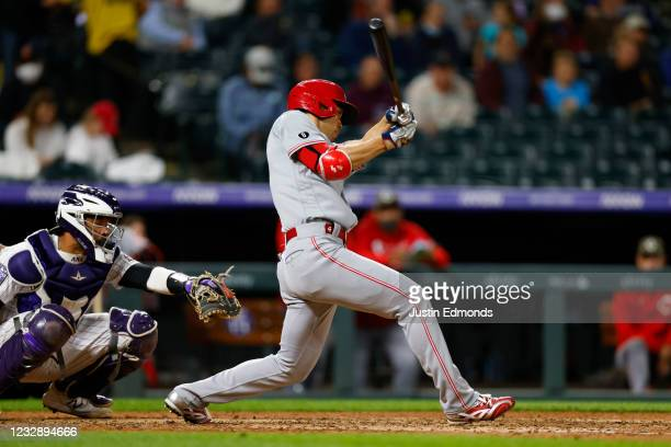 Shogo Akiyama of the Cincinnati Reds singles in the seventh inning against the Colorado Rockies at Coors Field on May 14, 2021 in Denver, Colorado.