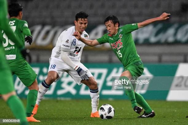 Shogo Hayashi of Tokyo Verdy and Dudu of Avispa Fukuoka compete for the ball during the JLeague J2 match between Tokyo Verdy and Avispa Fukuoka at...