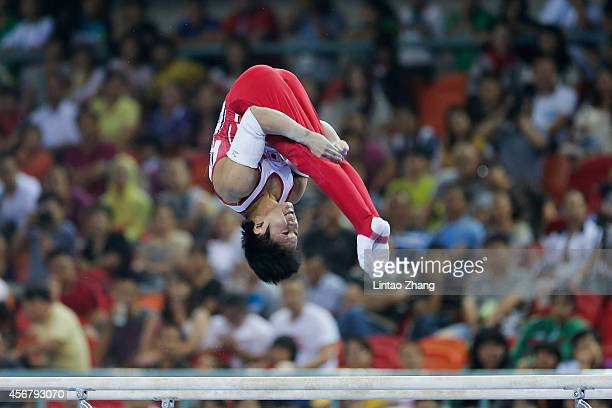 Shogo Nonomura of Japan competes on the Parallel Bars during the Men's Team Final of the 45th Artistic Gymnastics World Championships at Guangxi...