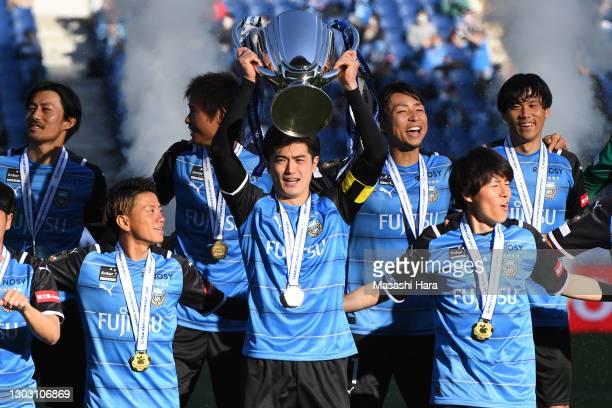 Shogo Taniguchi, captain of Kawasaki Frontale lifts the trophy after the Fuji Xerox Super Cup match between Kawasaki Frontale and Gamba Osaka at the...