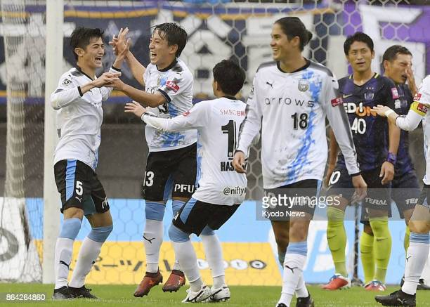 Shogo Taniguchi celebrates with Kawasaki Frontale teammates after opening the scoring in the first half of their 30 win away to Sanfrecce Hiroshima...