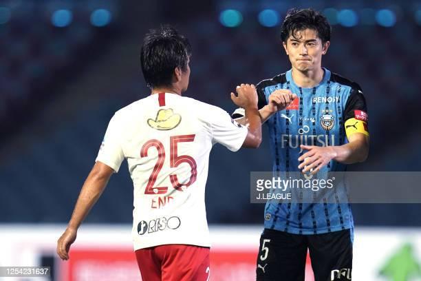 Shogo Taniguchi of Kawasaki Frontale and Yasushi Endo of Kashima Antlers elbow bumps after the J.League Meiji Yasuda J1 match between Kawasaki...