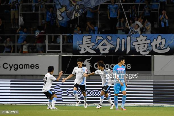 Shogo Taniguchi of Kawasaki Frontale celebrates scoring his side's first goal with his team mates during the JLeague J1 match between Sagan Tosu and...