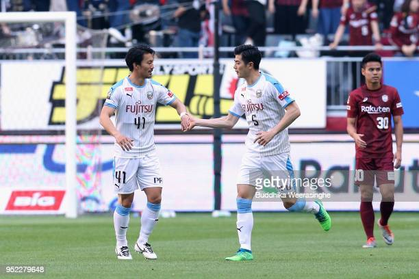 Shogo Taniguchi of Kawasaki Frontale celebrates scoring the opening goal with his team mate Akihiro Ienaga during the JLeague J1 match between Vissel...