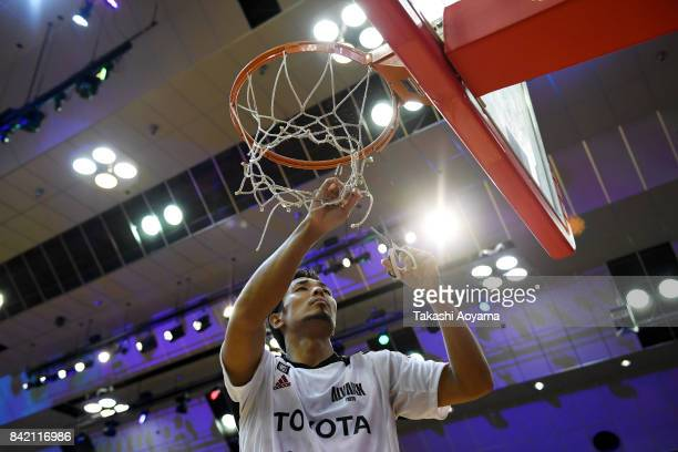Shohei Kikuchi of the Alvark Tokyo cuts down the net after defeating the Chiba Jets 77-73 in the B.League Kanto Early Cup final between Alvark Tokyo...