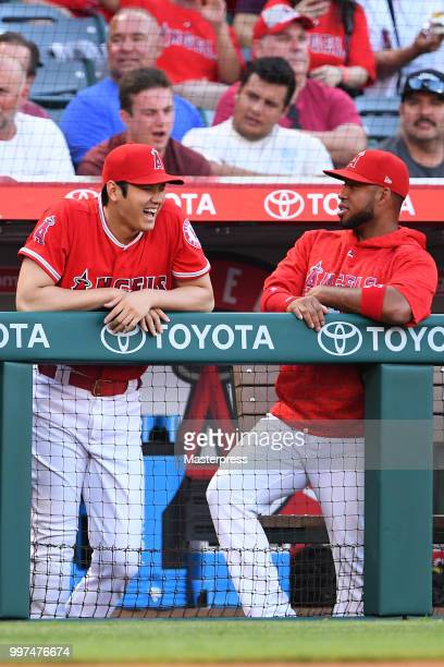 Shohei Ohtani and Luis Valbuena of the Los Angeles Angels of Anaheim smiles during the MLB game against the Seattle Mariners at Angel Stadium on July...