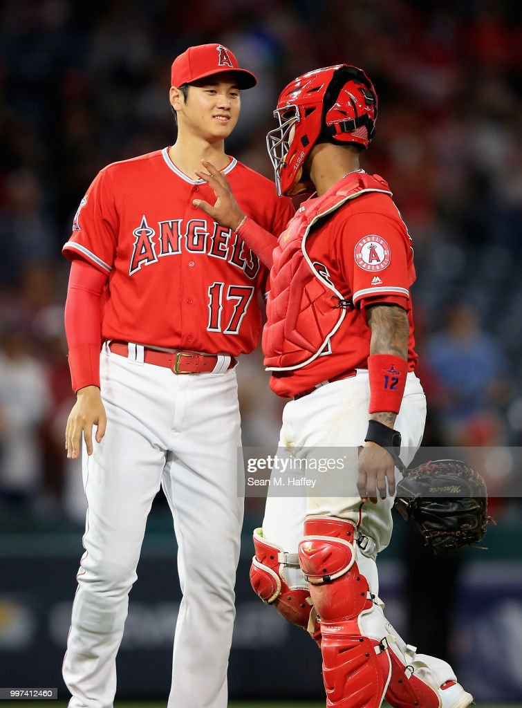 Shohei Ohtani #17 and Martin Maldonado #12 of the Los Angeles Angels of Anaheim celebrate defeating the Seattle Mariners 11-2 in a game at Angel Stadium on July 12, 2018 in Anaheim, California.