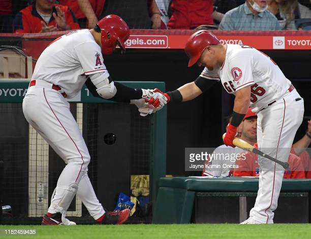 Shohei Ohtani gets a bow and a handshake from Kole Calhoun of the Los Angeles Angels after hitting a two run home rub in the third inning of the game...