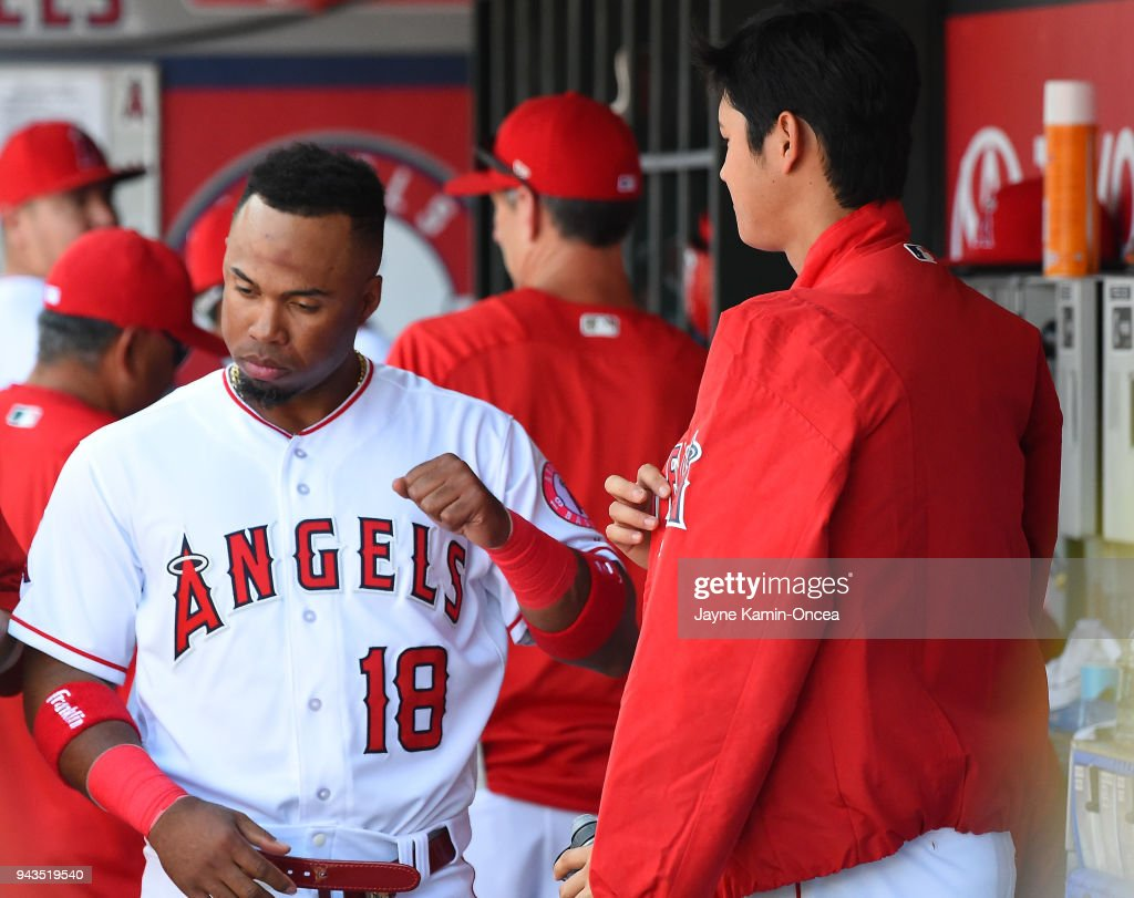 Shohei Ohtani #17 gets a handshake from Luis Valbuena #18 of the Los Angeles Angels after completing the seventh inning against the Oakland Athletics at Angel Stadium of Anaheim on April 8, 2018 in Anaheim, California.