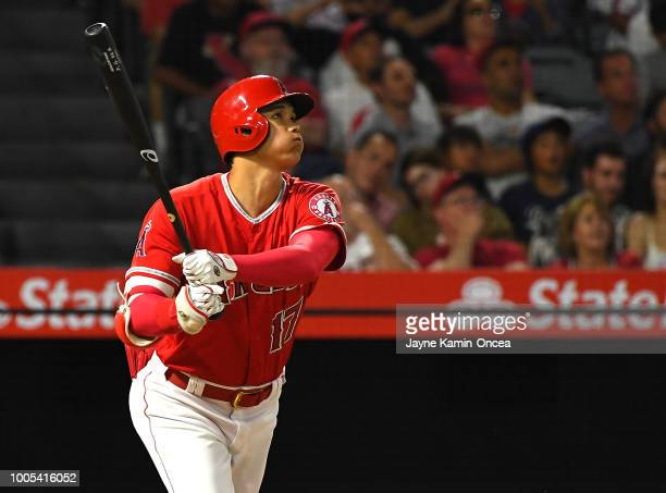 Shohei Ohtani hits a two run home run scoring Kole Calhoun of the Los Angeles Angels of Anaheim in the fifth inning against the Chicago White Sox at...