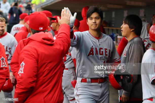 Shohei Ohtani Los Angeles Angels celebrates a third inning RBI after returning to the dugout while playing the Detroit Tigers on May 07, 2019 in...