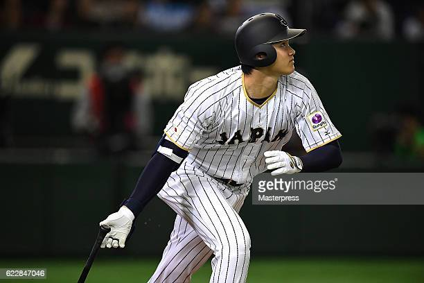 Shohei Ohtani of Japan hits a solo homer in the fifth inning during the international friendly match between Japan and Netherlands at the Tokyo Dome...