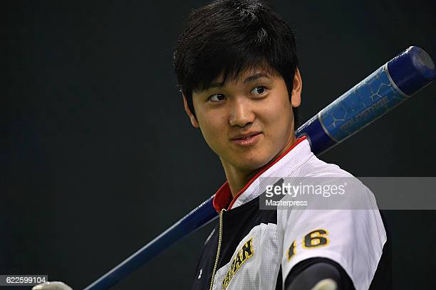 Shohei Ohtani of Japan is seen during the warmup ahead of the international friendly match between Japan and Netherlands at the Tokyo Dome on...