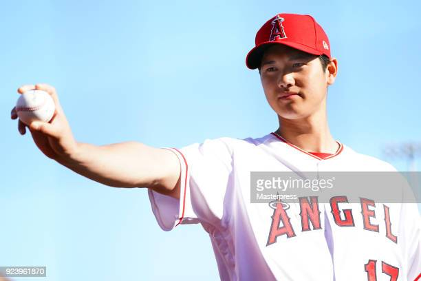 Shohei Ohtani of Los Angeles Angels pose for photographs during a training session on February 22 2018 in Tempe Arizona