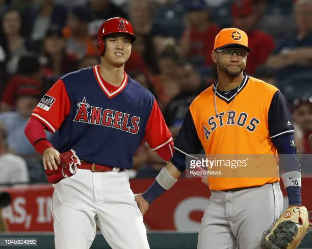 Shohei Ohtani of the Los Angeles Angels and Yuli Gurriel of the Houston Astros chat after Ohtani was hit by a pitch during the eighth inning of a...