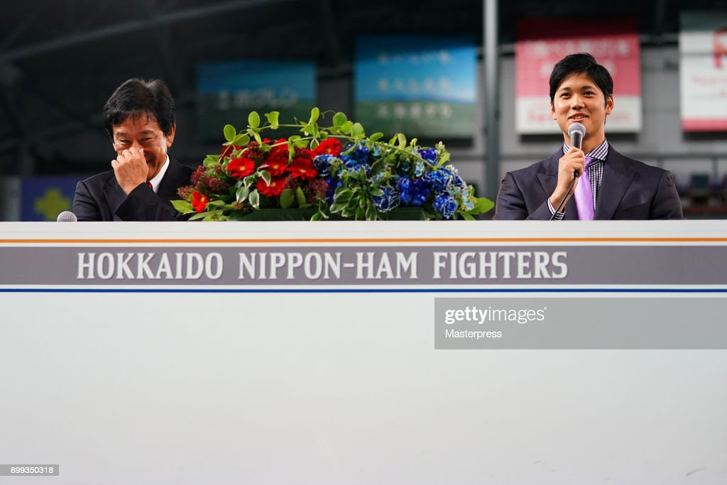 Shohei Ohtani of the Los Angeles Angels attends his farewell event with Hokkaido Nippon Ham Fighters head coach Hideki Kuriyama at Sapporo Dome on December 25, 2017 in Sapporo, Hokkaido, Japan.