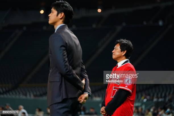 Shohei Ohtani of the Los Angeles Angels attends his farewell event with Hokkaido Nippon Ham Fighters head coach Hideki Kuriyama at Sapporo Dome on...