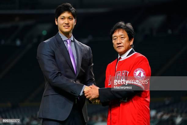 Shohei Ohtani of the Los Angeles Angels attends his farewell event with Hokkaido Nippon Ham Fighters head coach Hideki Kuriyama at Sapporo Dome on...