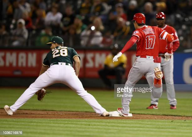 Shohei Ohtani of the Los Angeles Angels beats the ball to first base for a single in the seventh inning against the Oakland Athletics at Oakland...