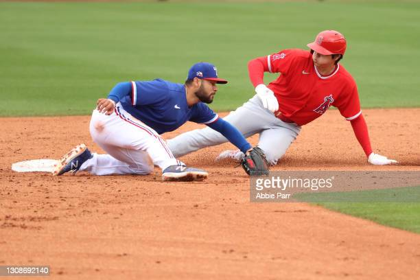 Shohei Ohtani of the Los Angeles Angels beats the tag by Isiah Kiner-Falefa of the Texas Rangers to slide safely into second base in the third inning...