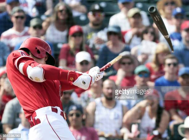 Shohei Ohtani of the Los Angeles Angels breaks his bat as he grounds out in the fourth inning of a spring training game against the Cincinnati Reds...