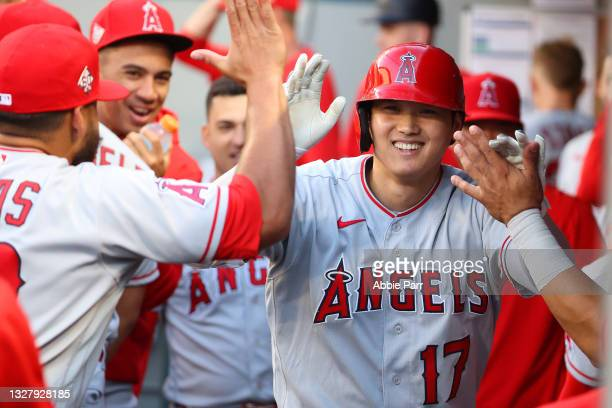 Shohei Ohtani of the Los Angeles Angels celebrates in the dugout after hitting a solo home run during the third inning against the Seattle Mariners...