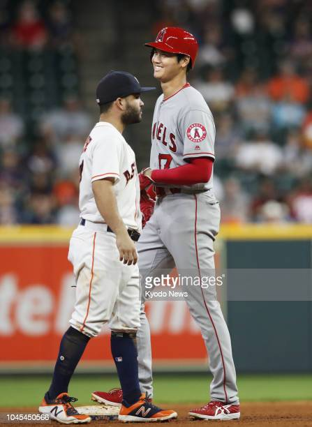Shohei Ohtani of the Los Angeles Angels chats with Jose Altuve of the Houston Astros on second base in the eighth inning of a game in Houston on Aug...