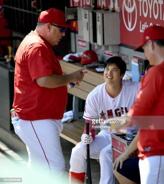Shohei Ohtani of the Los Angeles Angels chats with manager Mike Scioscia in the dugout ahead of the season's last game on Sept 30 in Anaheim...