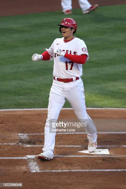 Shohei Ohtani of the Los Angeles Angels crosses home plate after hitting a home run in the first inning against the Kansas City Royals at Angel...