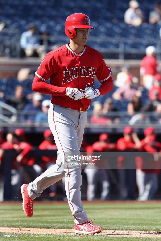 Shohei Ohtani #17 of the Los Angeles Angels draws a walk against the San Diego Padres during the third inning of the spring training game at Peoria Stadium on February 26, 2018 in Peoria, Arizona.