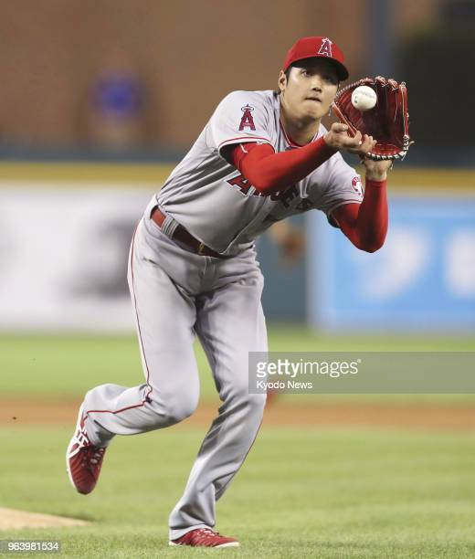Shohei Ohtani of the Los Angeles Angels fields a grounder off Detroit Tigers' Jeimer Candelario during the fifth inning of a game at Comerica Park in...