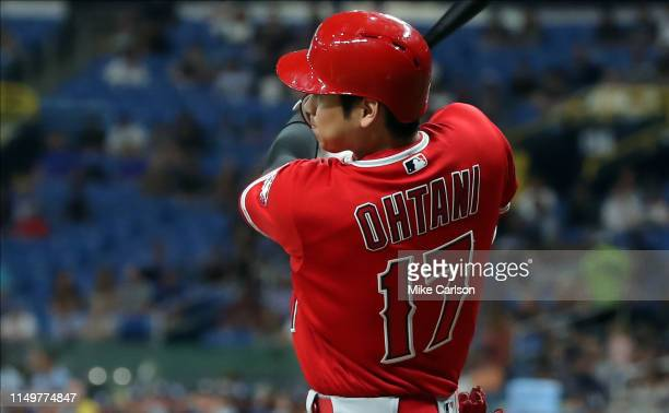 Shohei Ohtani of the Los Angeles Angels follows through on his single in the seventh inning of a baseball game against the Tampa Bay Rays at...