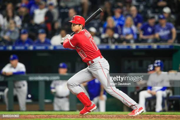 Shohei Ohtani of the Los Angeles Angels gets a base hit in the eighth inning against the Kansas City Royals at Kauffman Stadium on April 13 2018 in...