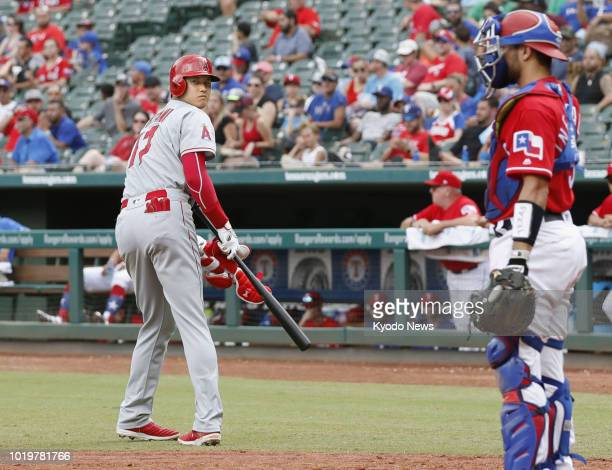 Shohei Ohtani of the Los Angeles Angels heads to first base after being given an intentional walk in the sixth inning of the team's 42 loss to the...