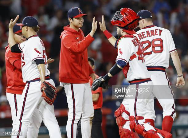 Shohei Ohtani of the Los Angeles Angels highfives catcher Anthony Bemboom after a 65 win over the Chicago White Sox on Aug 17 at Angel Stadium in...