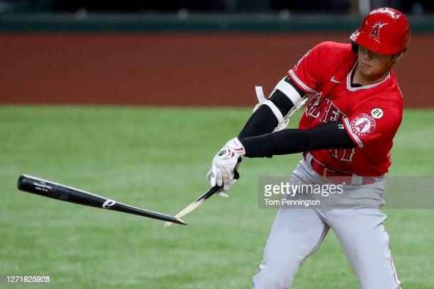 Shohei Ohtani of the Los Angeles Angels hit a broken bat single against the Texas Rangers in the top of the first inning at Globe Life Field on...