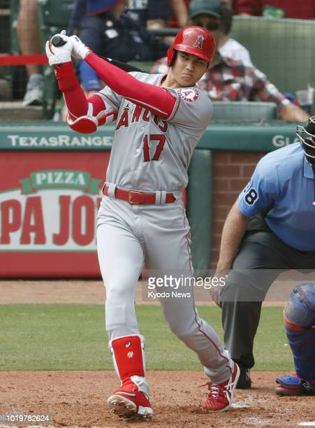 Shohei Ohtani of the Los Angeles Angels hits a double during the fourth inning of the team's 42 loss to the Texas Rangers in Arlington Texas on Aug...