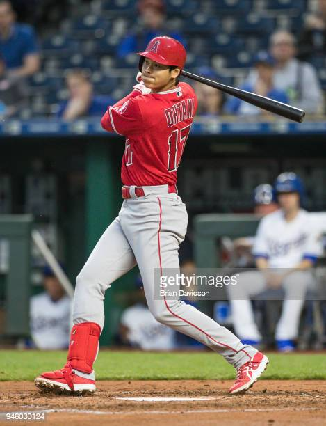 Shohei Ohtani of the Los Angeles Angels hits a double during the second inning against the Kansas City Royals at Kauffman Stadium on April 13 2018 in...