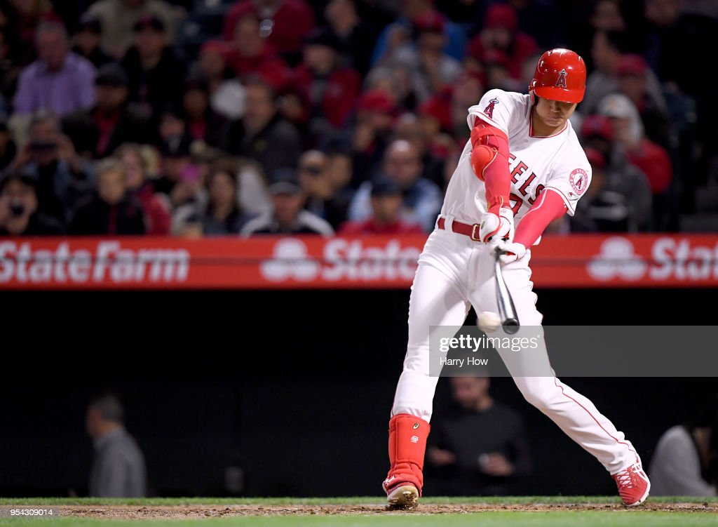 Shohei Ohtani #17 of the Los Angeles Angels hits a groundball during the fourth inning against the Baltimore Orioles at Angel Stadium on May 2, 2018 in Anaheim, California.