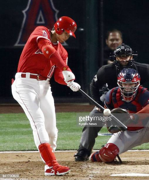 Shohei Ohtani of the Los Angeles Angels hits a home run in a game against the Cleveland Indians in Anaheim California on April 3 2018 ==Kyodo